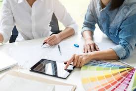 Interior Design Colour Chart Two Interior Design Or Graphic Designer At Work On Project Of