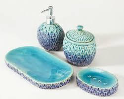 Towel Slippers And Shower Hooks Create That Total Bathroom Look Aqua Colored Bathroom Accessories