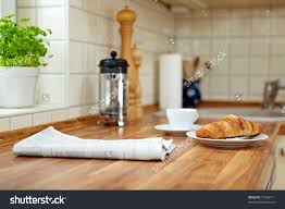 kitchen counter close up. Stock Photo Croissant And A Cup Of Coffee On Kitchen Counter Close Up ,