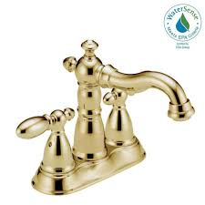 centerset 2 handle bathroom faucet with metal drain assembly in polished brass