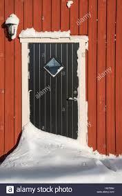 doorway blocked by snow caused by snowdrift in the winter sweden scandinavia