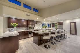 contemporary kitchen with oak laminate flooring and long breakfast bar island