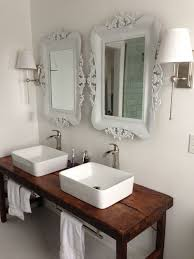 bathroom vessel sinks wood table white bathroom with vessel sinks and wood table as vanity like the tab