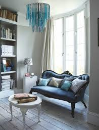 blue glass chandelier lighting interior design using blue in room with blue sofa lights