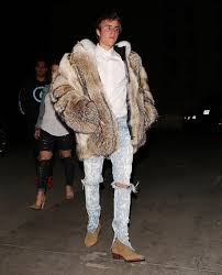 justin bieber wears burberry fur coat fear of jeans and saint lau boots