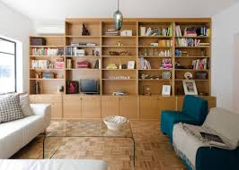 Storage Systems Variety for the Living Room. Wall unit of the light timber  color with