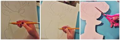 while the paint dried i cut a piece of poster board down to a size similar to the art plaque i used a pencil to sketch up a deer silhouette  on poster board wall art with the lovely side diy glittery deer silhouette wall art