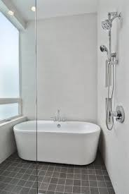 small bathroom with freestanding tub as well featuring standing