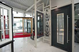 aluminium entrance door in ral 7016 with centre glass panel and oversized stainless steel handle
