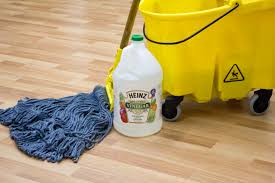 use a water and vinegar solution to clean laminate flooring