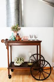 LOVE this bar cart! Rue Magazine (March/April Decorated by Bash, Please.  Photographed by Laure Joliet.