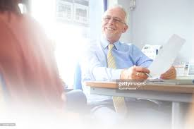 Financial Advisor Happy To Help Single Mother High-Res Stock Photo - Getty  Images