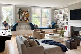 bay window seating diy living room contemporary with tv above fireplace fl arrangement blue and brown