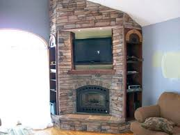 corner fireplace with tv above google search