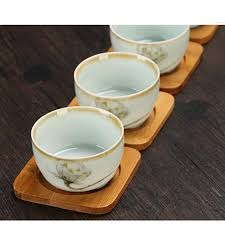 Cone-shaped piece with asian tea set