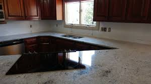 light color granite countertops kitchen countertop with sink cutout and cooktop stove cutout