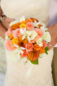 couple and bouquet with mango calla lilies orange roses light pink roses white