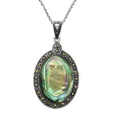 the necklace features an oval stone encased with sparkling marcasite crafted in sterling silver the pendant hangs from