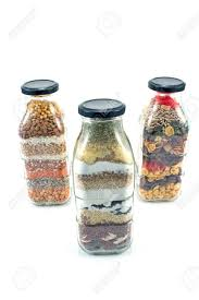 Decorative Pepper Bottles Decorative Glass Bottles With Seeds Isolated On White Stock Photo 72