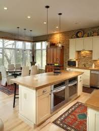ideas on how to decorate above your kitchen cabinets see more love the concrete countertops in warm brown windows in the dining area kitchen oven