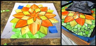 here you can see the progress on the background followed by a grouting shot which shows a piece of the custom made frame which all the flowers get