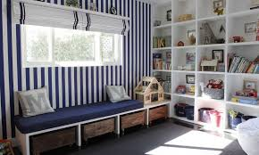 striped walls and diffe storage system for playroom