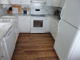 vinyl plank flooring kitchen with stylish white u shapes design hardwood and tiles interior cabinetry set on brown polished in small place