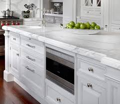 amazing white kitchen with endless kitchen island with built in microwave nook small round prep sink with polished nickel vintage faucet and beveled marble