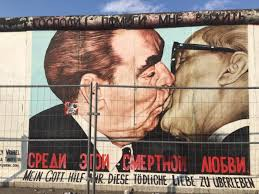 the most famous mural of the east side gallery fraternal kiss or bruderkuss is based on a famous photograph which was later painted by dmitri vrubel  on most famous wall artist with gaga for graffiti political statements in berlin atlas adrift
