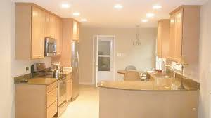 galley kitchen lighting ideas. Interior. Some Patching Lamps On The Ceiling And Brown Wooden Kitchen Cabinet Connected By Cream Galley Lighting Ideas