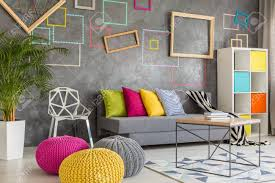 colorful living rooms. Colorful Living Room With Decorative Grey Wall And Wool Poufs Stock Photo - 64791747 Rooms O