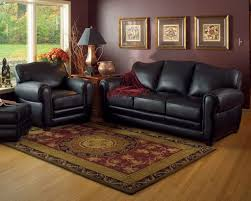 black leather living room furniture. traditional living room designed with black leather furniture and dark brown walls o