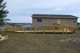 wide view of ada post and beam wood wheelchair ramp