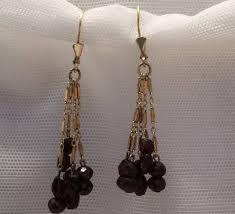 vintage gold brass garnet earrings red burdy garnet chandelier earrings mid century garnet earrings made in germany bohemian earrings