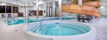 indoor pool with waterslide. Hot Tub Beside Indoor Pool With Spiral Waterslide