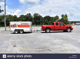 A 2007 Chevrolet Truck towing a tandem axle U-Haul Trailer Stock ...