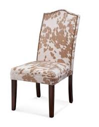 the perfect addition to your living room seating group or master suite vanity this wood framed side chair showcases cowhide inspired upholstery and