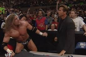 Image result for schwarzenegger wwe triple h