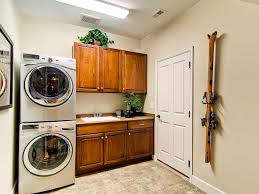 Warm Wood Cabinetry In Laundry Room (Image 24 of 26)