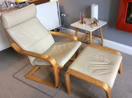 ikea poang recliner chair and footstool in cream leather