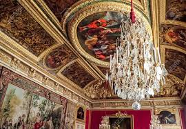 Chandelier And Painted Ceiling At Versailles