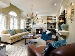 appropriate feng shui living room with beige sofa also blue arm chairplus chandelier medium