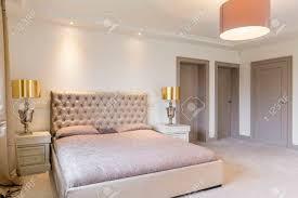 Very beautiful and stylish bedroom with quilted bed backboard..