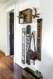 Compact old signs and crate coat hook area made with Funky Junk's Old Sign  Stencils /