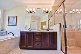 master bath looks gorgeous with arts and crafts style lighting for awesome look