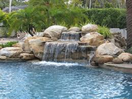 luxury pools stone walk in pool w beach sand luxury gardens luxury waterfall