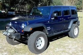 4 door navy blue jeep wrangler