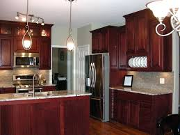 restained kitchen cabinets painting over stained cabinets in the kitchen ed painting over stained kitchen cupboards