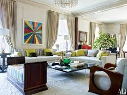 at the plaza hotel an artwork by mark grotjahn brightens the living room in a manhattan
