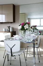 ikea dining room table kitchen table sets chairs glass top table flowers wall cabinet window glasses